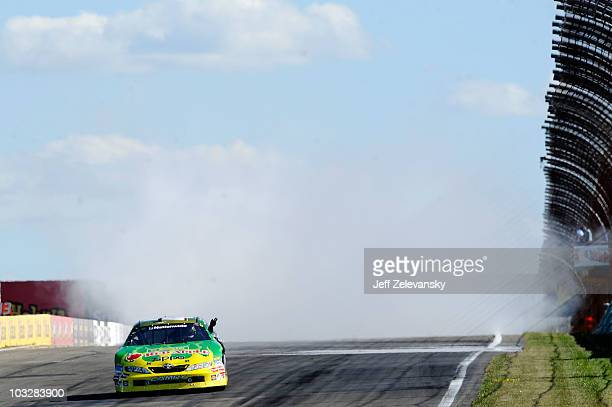Marcos Ambrose, driver of the Kwik Fil/Zippo Chevrolet, performs a burn out after winning the NASCAR Nationwide Series Zippo 200 at Watkins Glen...