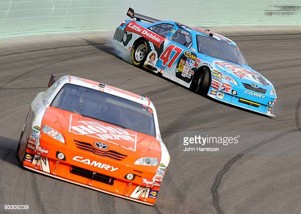 Marcos Ambrose, driver of the Little Debbie/Kingsford/Clorox Toyota, spins out of control behind Joey Logano, driver of the Home Depot Toyota, during...