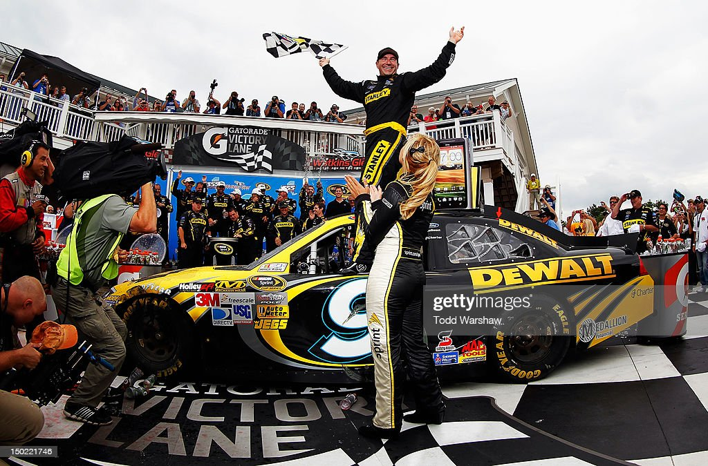Marcos Ambrose, driver of the #9 Stanley Ford, celebrates in Victory Lane after winning the NASCAR Sprint Cup Series Finger Lakes 355 at the Glen at Watkins Glen International on August 12, 2012 in Watkins Glen, New York.
