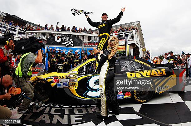 Marcos Ambrose, driver of the Stanley Ford, celebrates in Victory Lane after winning the NASCAR Sprint Cup Series Finger Lakes 355 at the Glen at...
