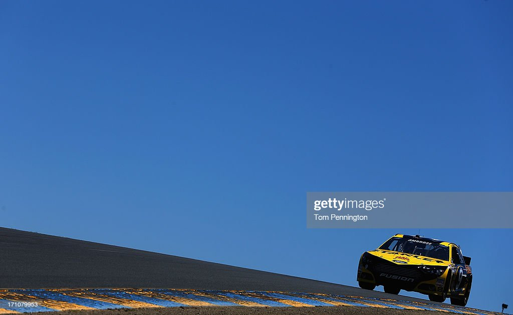 Marcos Ambrose, driver of the #9 Stanley Ford, drives during practice for the NASCAR Sprint Cup Series Toyota/Save Mart 350 at Sonoma Raceway on June 21, 2013 in Sonoma, California.