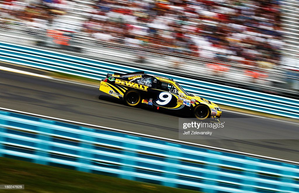 Marcos Ambrose, driver of the #9 Stanley Ford, races during the NASCAR Sprint Cup Series Finger Lakes 355 at the Glen at Watkins Glen International on August 12, 2012 in Watkins Glen, New York.