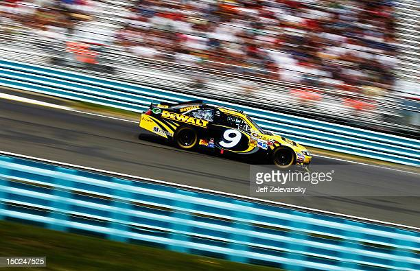 Marcos Ambrose, driver of the Stanley Ford, races during the NASCAR Sprint Cup Series Finger Lakes 355 at the Glen at Watkins Glen International on...
