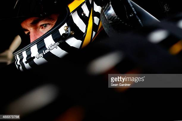 Marcos Ambrose, driver of the Stanley Ford, sits in his car during practice for the NASCAR Sprint Cup Series MyAFibStory.com 400 at Chicagoland...