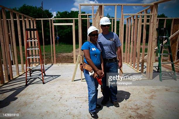 Marcos Ambrose driver of the Stanley Ford works building a home for Tora Barnes with Habitat For Humanity volunteers on April 11 2012 in Fort Worth...