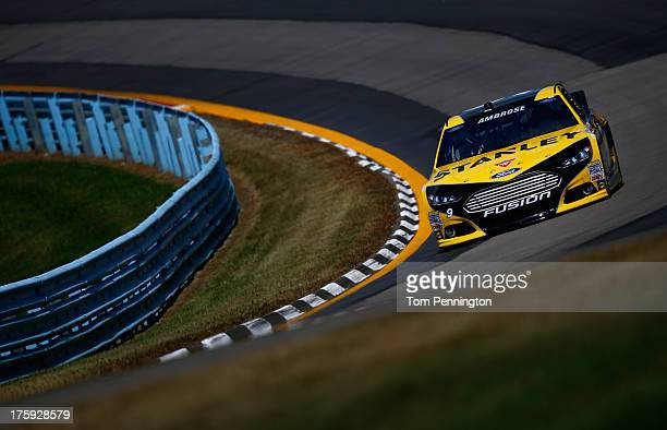 Marcos Ambrose, driver of the Stanley/CTC Jumpstart Ford, drives during qualifying for the NASCAR Sprint Cup Series Cheez-It 355 at The Glen at...