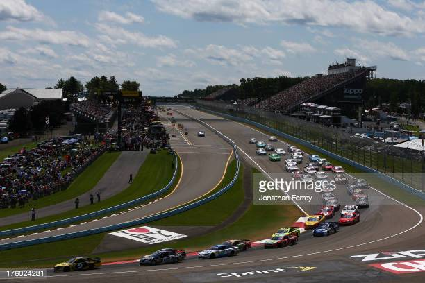 Marcos Ambrose, driver of the Stanley/CTC Jumpstart Ford, leads the field during the NASCAR Sprint Cup Series Cheez-It 355 at The Glen at Watkins...