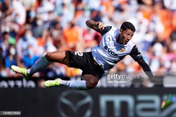 Marcos Andre of Valencia CF jumps for the ball during the La Liga Santander match between Valencia CF and RCD Mallorca at Estadio Mestalla on October...