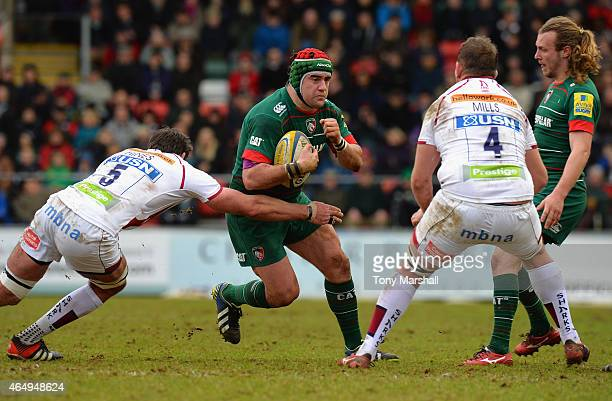 Marcos Ayerza of Leicester Tigers is tackled by Nathan Hines of Sale Sharks during the Aviva Premiership match between Leicester Tigers and Sale...