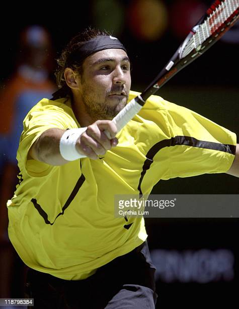 Marcos Baghdatis lunges for the ball during his fourthround match against Roger Federer during during the 2005 Australian Open at Melbourne Park in...