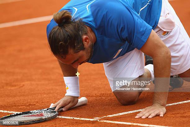 Marcos Baghdatis of Cyprius kisses the field after winning his match against Philipp Kohlschreiber of Germany on day 6 of the BMW Open at the Iphitos...