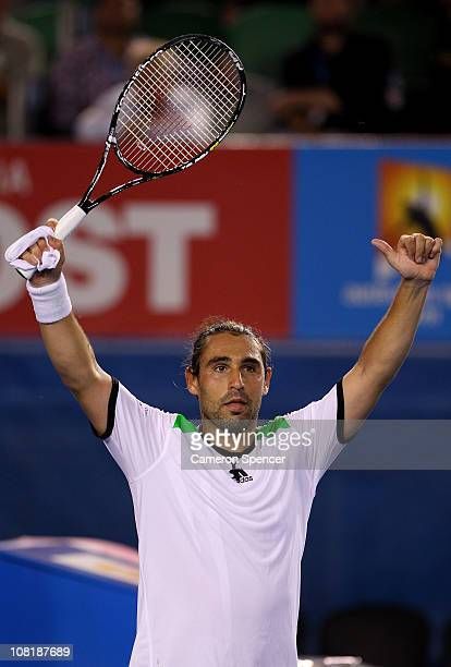 Marcos Baghdatis of Cyprus celebrates after winning his second round match against Juan Martin Del Potro of Argentina during day four of the 2011...