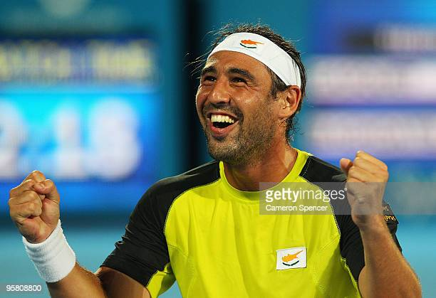 Marcos Baghdatis of Cyprus celebrates championship point in his men's final against Richard Gasquet of France during day seven of the 2010 Medibank...