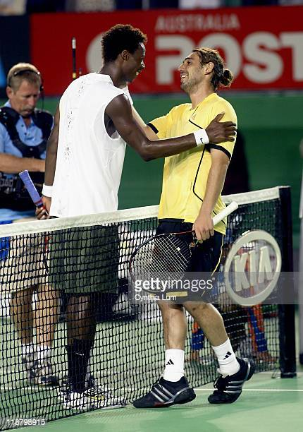 Marcos Baghdatis of Cyprus, congratulates Gael Monfil of France, on his 7-6, 6-2, 2-6, 6-0 victory over 11th seed, Baghdatis. In the second round of...