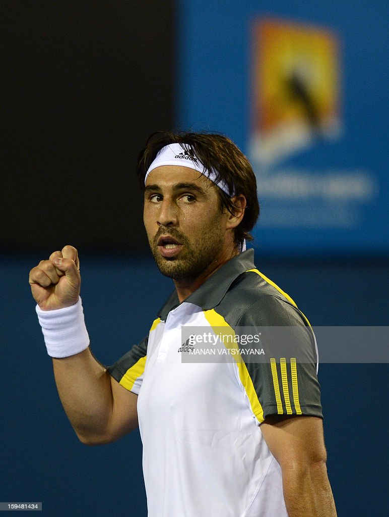 Marcos Baghdatis of Cyprus gestures after brealing serve during his men's singles match against Albert Ramos of Spain on the first day of the Australian Open tennis tournament in Melbourne on January 14, 2013.