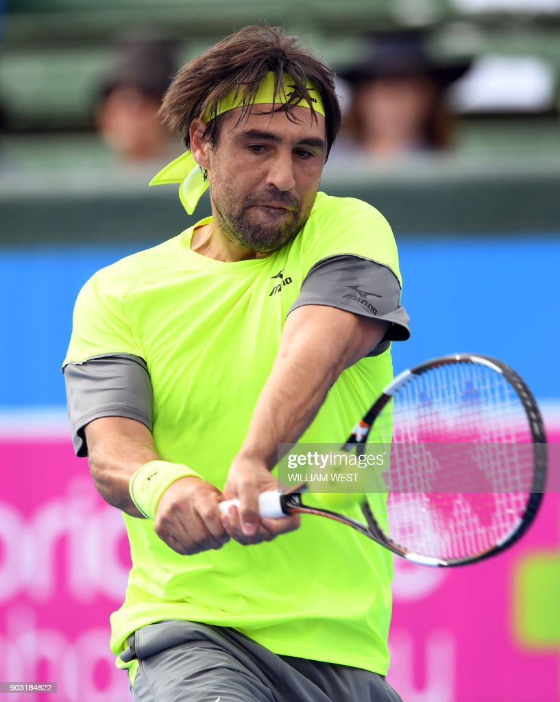 Marcos Baghdatis of Cyprus hits a backhand return during his match with Kevin Anderson of South Africa at Kooyong Classic tennis tournament in Melbourne on January 10, 2018. /