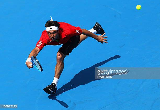Marcos Baghdatis of Cyprus hits a forehand during his semi final match against Julien Benneteau of France during day six of the 2012 Sydney...