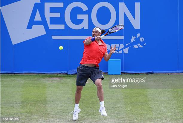 Marcos Baghdatis of Cyprus in action against David Ferrer of Spain on day three of the Aegon Open Nottingham at Nottingham Tennis Centre on June 23...