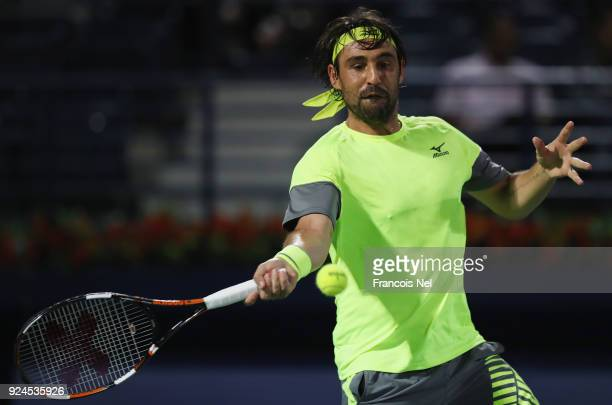 Marcos Baghdatis of Cyprus in action against Victor Troicki of Serbia during day one of the ATP Dubai Duty Free Tennis Championships at the Dubai...