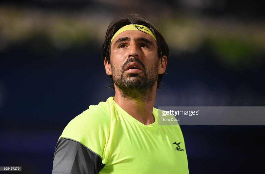Marcos Baghdatis of Cyprus looks up during his match against Filip Krajinovic of Serbia on day three of the ATP Dubai Duty Free Tennis Championships at the Dubai Duty Free Stadium on February 28, 2018 in Dubai, United Arab Emirates.