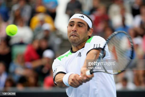Marcos Baghdatis of Cyprus plays a backhand in his first round match against Grega Zemlja of Slovenia during day two of the 2011 Australian Open at...