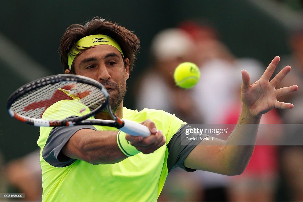 Marcos Baghdatis of Cyprus plays a forehand against Kevin Anderson of South Africa in the 2018 Kooyong Classic at Kooyong on January 10, 2018 in Melbourne, Australia.