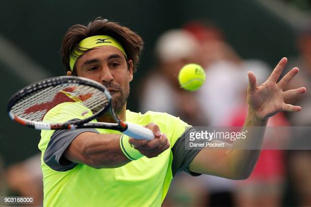 Marcos Baghdatis of Cyprus plays a forehand against Kevin Anderson of South Africa in the 2018 Kooyong Classic at Kooyong on January 10 2018 in...