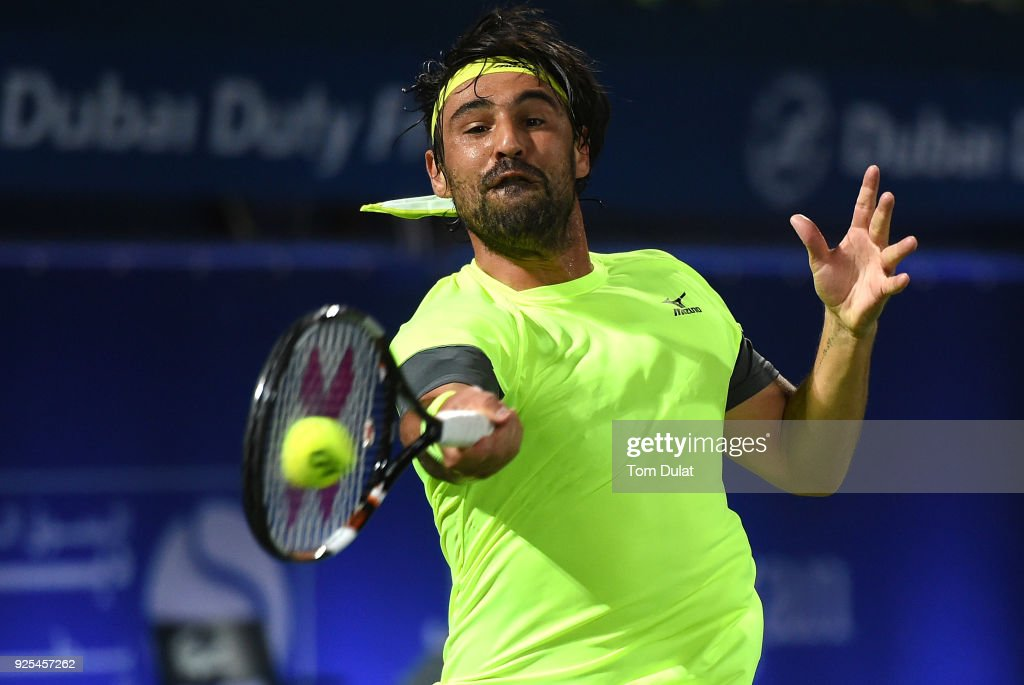 Marcos Baghdatis of Cyprus plays a forehand during his match against Filip Krajinovic of Serbia on day three of the ATP Dubai Duty Free Tennis Championships at the Dubai Duty Free Stadium on February 28, 2018 in Dubai, United Arab Emirates.