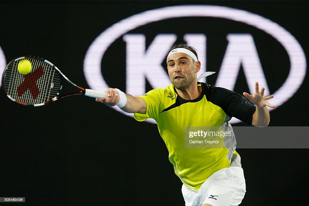 Marcos Baghdatis of Cyprus plays a forehand in his first round match against Jo-Wilfried Tsonga of France during day one of the 2016 Australian Open at Melbourne Park on January 18, 2016 in Melbourne, Australia.
