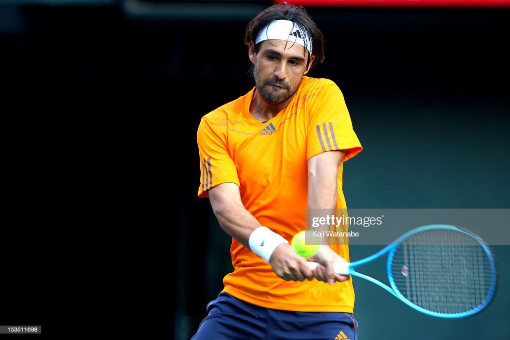 Marcos Baghdatis of Cyprus plays a forehand in his match against Kei Nishikori of Japan during day six of the Rakuten Open at Ariake Colosseum on October 6, 2012 in Tokyo, Japan.