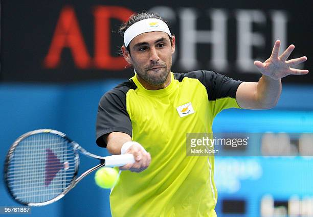 Marcos Baghdatis of Cyprus plays a forehand in his quarter final match against Lleyton Hewitt of Australia during day five of the 2010 Medibank...