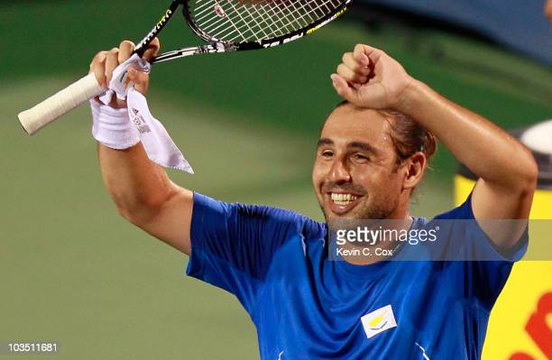 Marcos Baghdatis of Cyprus reacts after defeating Rafael Nadal of Spain during Day 5 of the Western Southern Financial Group Masters at the Lindner...