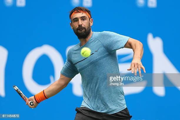 Marcos Baghdatis of Cyprus returns a shot during the match against Viktor Troicki of Serbia during Day 4 of 2016 ATP Chengdu Open at Sichuan...