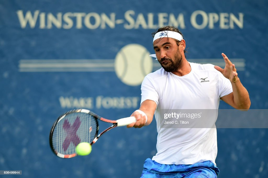 Marcos Baghdatis of Cyprus returns a shot from Jiri Vesely of Czech Republic during the third day of the Winston-Salem Open at Wake Forest University on August 21, 2017 in Winston Salem, North Carolina.