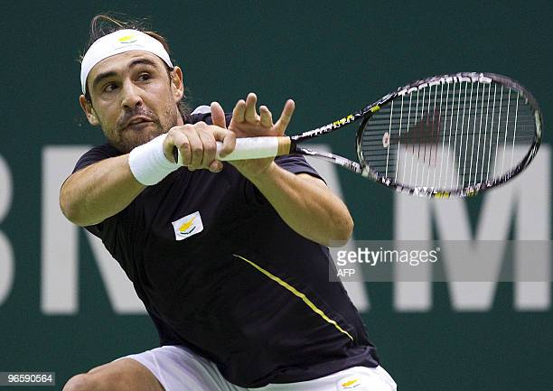 Marcos Baghdatis of Cyprus returns the ball to Russian Nikolay Davydenko in their secondround clash during the ABN Amro World Tennis Tournament in...