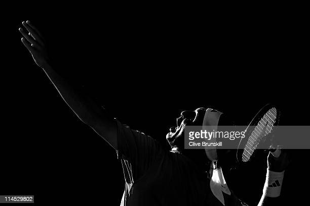 Marcos Baghdatis of Cyprus serves during the men's singles first round match between Marcos Baghdatis of Cyprus and Frederico Gil of Portugal on day...
