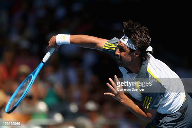Marcos Baghdatis of Cyprus serves in his second round match against Tatsuma Ito of Japan during day three of the 2013 Australian Open at Melbourne...