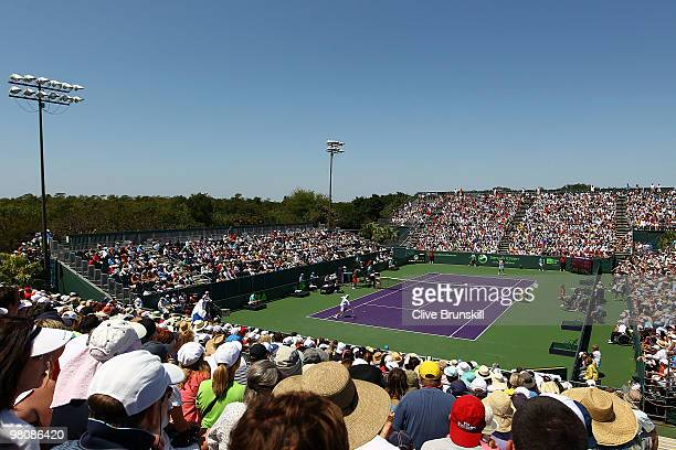 Marcos Baghdatis of Cyprus takes on Juan Ignacio Chela of Argentina during day five of the 2010 Sony Ericsson Open at Crandon Park Tennis Center on...