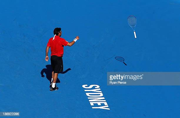 Marcos Baghdatis of Cyprus throws his racquet during his semi final match against Julien Benneteau of France during day six of the 2012 Sydney...