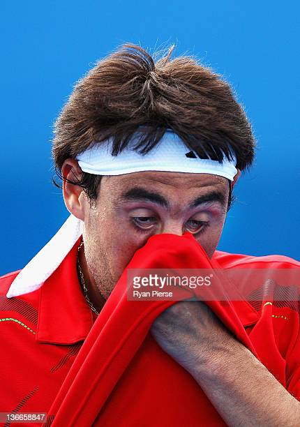 Marcos Baghdatis of Cyprus wipes his face during his second round match again Dmitry Tursunov of Russia during day three of the 2012 Sydney...