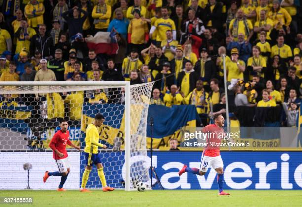 Marcos Bolados of Chile celebrates after scoring to 12 during the International Friendly match between Sweden and Chile at Friends arena on March 24...