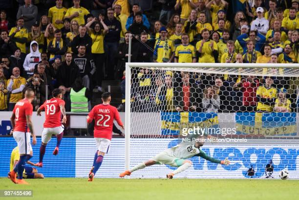 Marcos Bolados of Chile scores the decisive goal to 12 during the International Friendly match between Sweden and Chile at Friends arena on March 24...