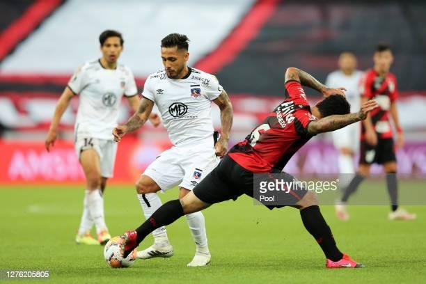 Marcos Bolados of of ColoColo fights for the ball with Márcio Azevedo of Athletico Paranaense during a group C match of Copa CONMEBOL Libertadores...