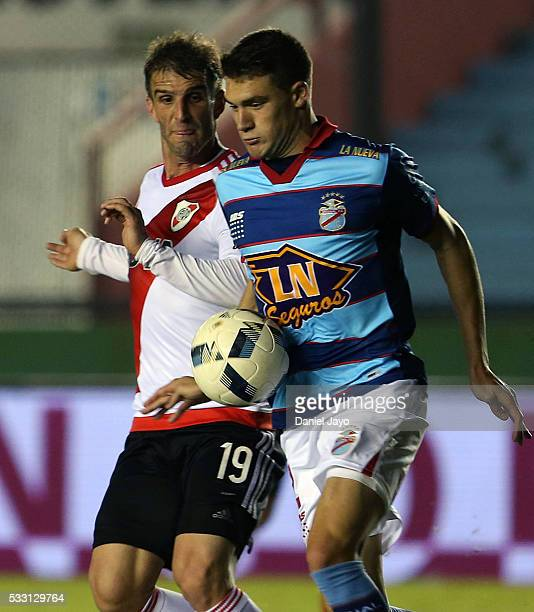 Marcos Curado of Arsenal FC and Ivan Alonso of River Plate fight for the ball during a match between Arsenal FC and River Plate as part of round 16...