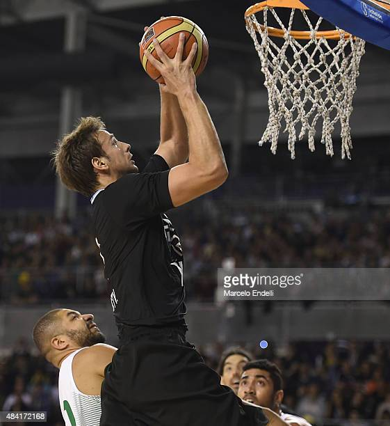 Marcos Delia of Argentina dunks the ball during a match between Argentina and Brazil as part of Four Nations Championship at Tecnopolis Stadium on...