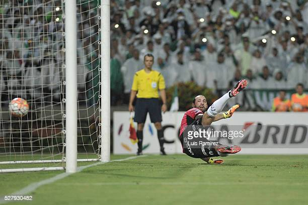 Marcos Diaz goalkeeper of Huracan fails to stop a penalty kicked by Victor Ibarbo of Atletico Nacional during a second leg match between Atletico...