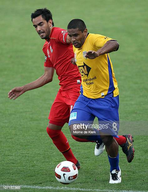 Marcos Flores of Adelaide and Anderson Alves Da Silva of the Gold Coast compete for the ball during the round 16 ALeague match between Adelaide...