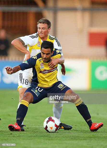 Marcos Flores of the Mariners competes with Ben Sigmund of the Phoenix during the round six ALeague match between the Central Coast Mariners and...