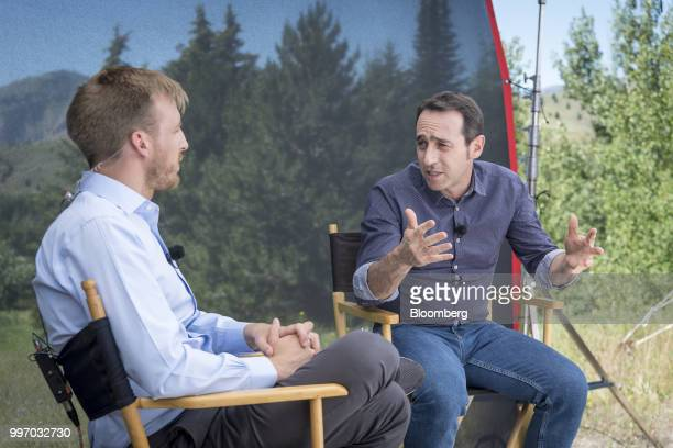Marcos Galperin cofounder and chief executive officer of MercadoLibre Inc right speaks during a Bloomberg Television interview at the Allen Co Media...