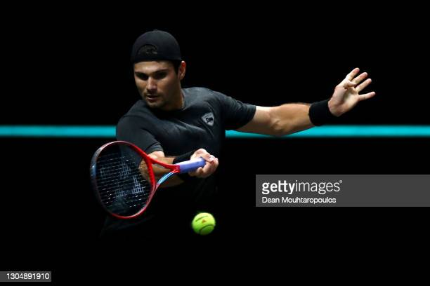 Marcos Giron of USA returns a forehand in his match against Andrey Rublev of Russia during Day 2 of the 48th ABN AMRO World Tennis Tournament at Ahoy...